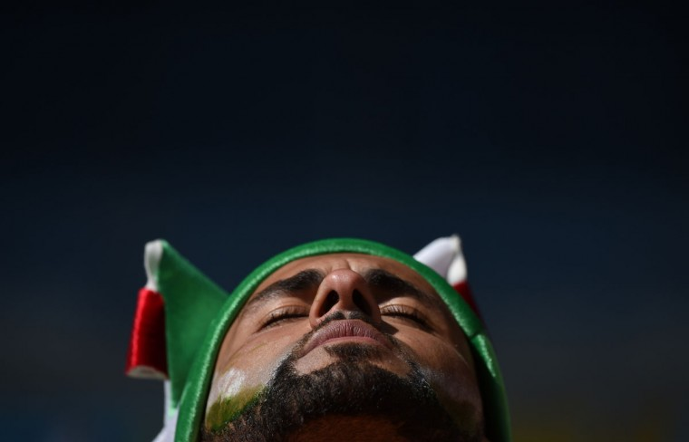 An Algerian fan is pictured prior to a Group H football match between Belgium and Algeria at the Mineirao Stadium in Belo Horizonte during the 2014 FIFA World Cup on June 17, 2014. (Christophe SImon/AFP/Getty Images)