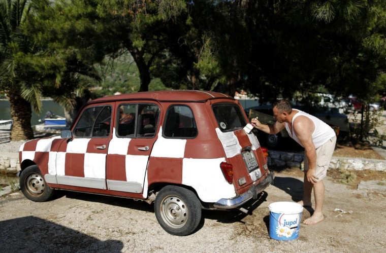A Croatian soccer fan paints his car to resemble the Croatian national flag in Zaton, south Croatia June 12, 2014. Croatia will be playing against Brazil at their World Cup soccer match today in Sao Paulo. (Antonio Bronic/Reuters)