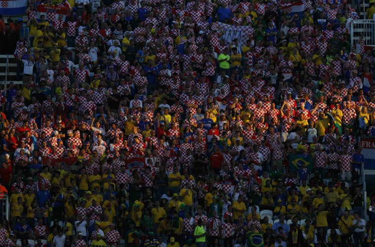 Croatian and Brazilian fans cheer before the 2014 World Cup opening ceremony at the Corinthians arena in Sao Paulo June 12, 2014. (Ivan Alvarado/Reuters)