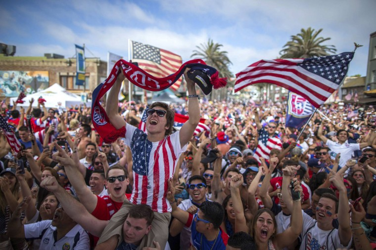 Fans cheer after the U.S. scored a second goal during the 2014 Brazil World Cup Group G soccer match between Ghana and the U.S. at a viewing party in Hermosa Beach, California June 16, 2014. (Lucy Nicholson/Reuters)