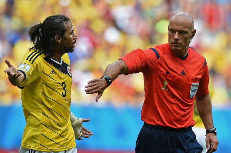 Colombia's defender and captain Mario Alberto Yepes (L) argues next to British referee Howard Webb during a Group C football match between Colombia and Ivory Coast at the Mane Garrincha National Stadium in Brasilia during the 2014 FIFA World Cup on June 19, 2014. (Eitan Abram Movich/AFP/Getty Images)