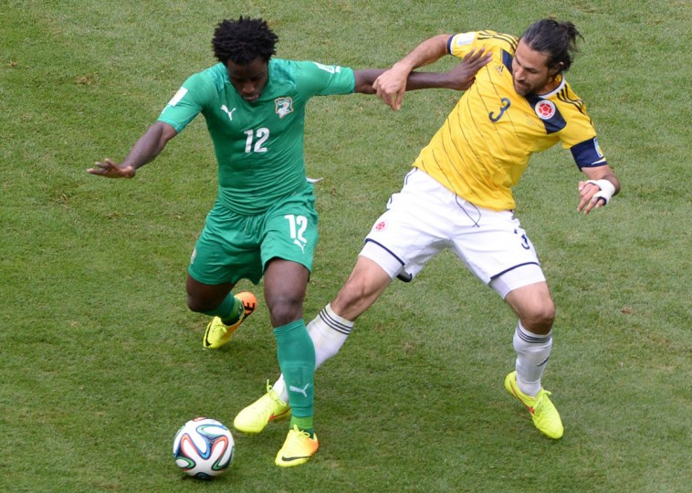 Ivory Coast's forward Wilfried Bony (L) challenges Colombia's defender Mario Alberto Yepes during the Group C football match between Colombia and Ivory Coast at the Mane Garrincha National Stadium in Brasilia during the 2014 FIFA World Cup on June 19, 2014. (Evaristo Sa/AFP/Getty Images)
