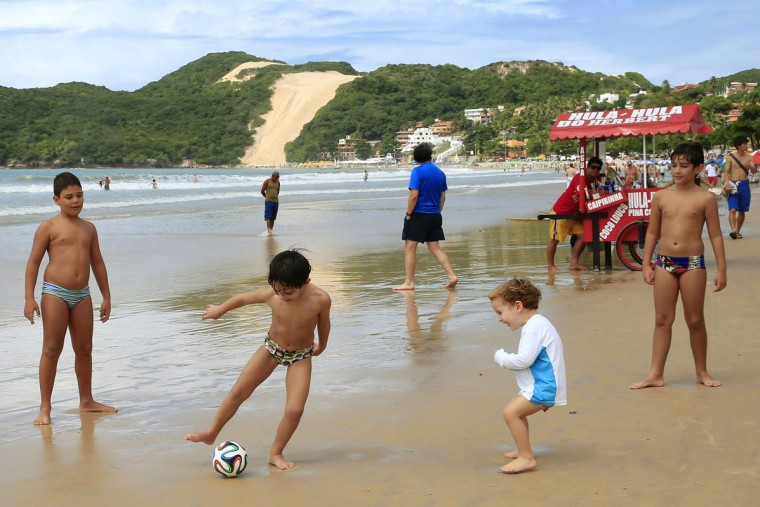 Children play soccer on Ponta Negra beach. (Winslow Townson-USA TODAY Sports)