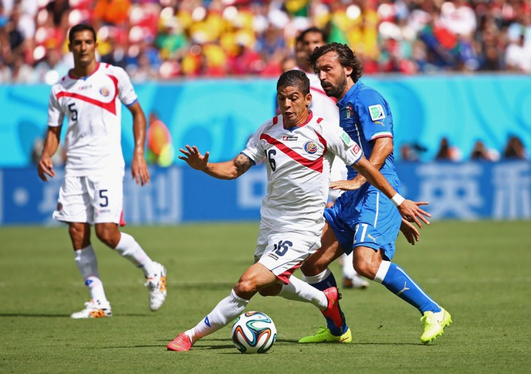 Cristian Gamboa of Costa Rica controls the ball against Andrea Pirlo of Italy during the 2014 FIFA World Cup Brazil Group D match between Italy and Costa Rica at Arena Pernambuco on June 20, 2014 in Recife, Brazil. (Photo by Robert Cianflone/Getty Images)