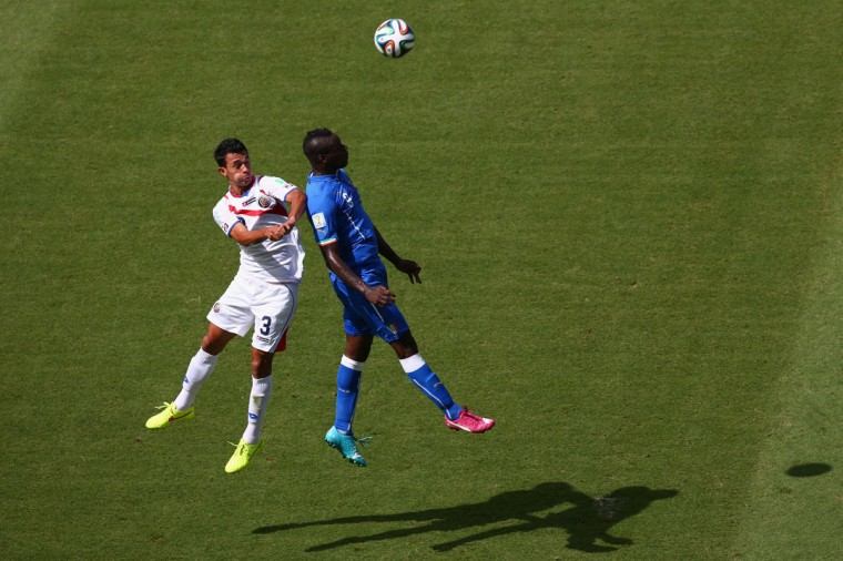 Mario Balotelli and Giancarlo Gonzalez of Costa Rica go up for a header during the 2014 FIFA World Cup Brazil Group D match between Italy and Costa Rica at Arena Pernambuco on June 20, 2014 in Recife, Brazil. (Photo by Michael Steele/Getty Images)