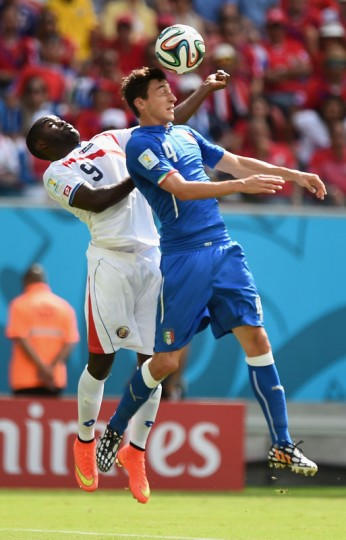 Mario Balotelli of Italy and Joel Campbell of Costa Rica go up for a header during the 2014 FIFA World Cup Brazil Group D match between Italy and Costa Rica at Arena Pernambuco on June 20, 2014 in Recife, Brazil. (Photo by Laurence Griffiths/Getty Images)