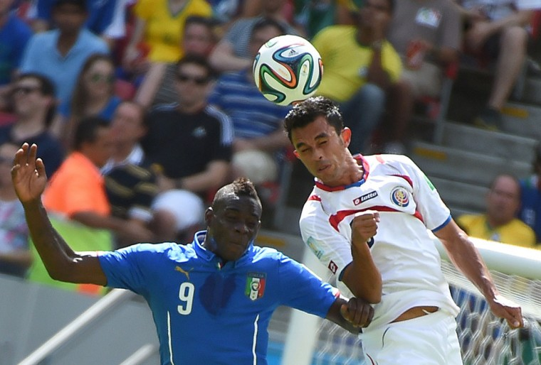 Italy's forward Mario Balotelli (L) and Costa Rica's defender Giancarlo Gonzalez vie for the ball during a Group D football match between Italy and Costa Rica at the Pernambuco Arena in Recife during the 2014 FIFA World Cup on June 20, 2014. (Emmanuel Duand/AFP/Getty Images)