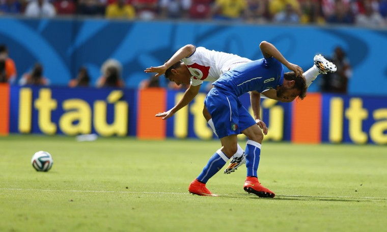 Costa Rica's Oscar Duarte fouls Italy's Claudio Marchisio (front) during their 2014 World Cup Group D soccer match at the Pernambuco arena in Recife June 20, 2014. (Dominic Ebenbichler/Reuters)