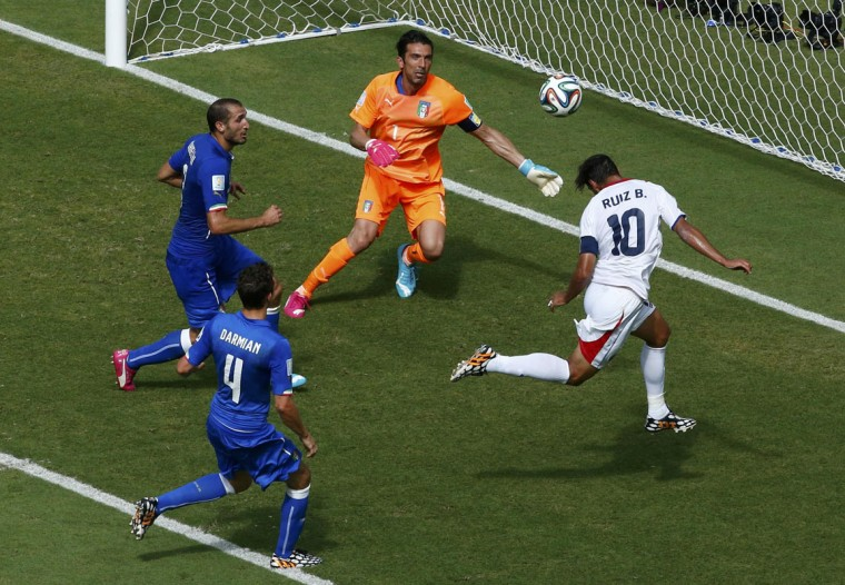 Costa Rica's Bryan Ruiz (R) scores a goal against Italy's Gianluigi Buffon (1) during their 2014 World Cup Group D soccer match at the Pernambuco arena in Recife June 20, 2014. (Ruben Sprich/Reuters)
