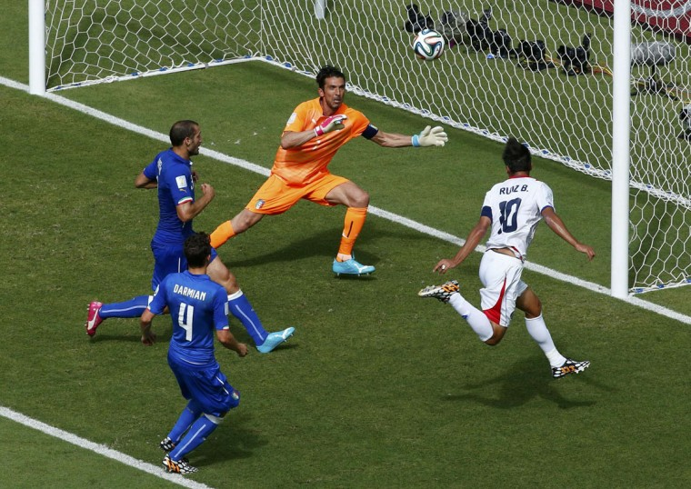 Costa Rica's Bryan Ruiz (R) scores a goal against Italy's Gianluigi Buffon (2nd R) during their 2014 World Cup Group D soccer match at the Pernambuco arena in Recife June 20, 2014. (Ruben Sprich/Reuters)