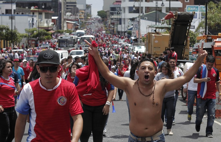 Costa Rican soccer fans celebrate their win over Italy after their 2014 World Cup soccer match in San Jose June 20, 2014. (Juan Carlos Ulate/Reuters)
