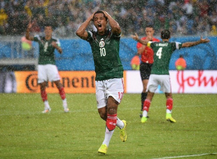 Giovani dos Santos of Mexico reacts after his goal was disallowed due to an offsides call in the first half during the 2014 FIFA World Cup Brazil Group A match between Mexico and Cameroon at Estadio das Dunas on June 13, 2014 in Natal, Brazil. (Photo by Matthias Hangst/Getty Images)