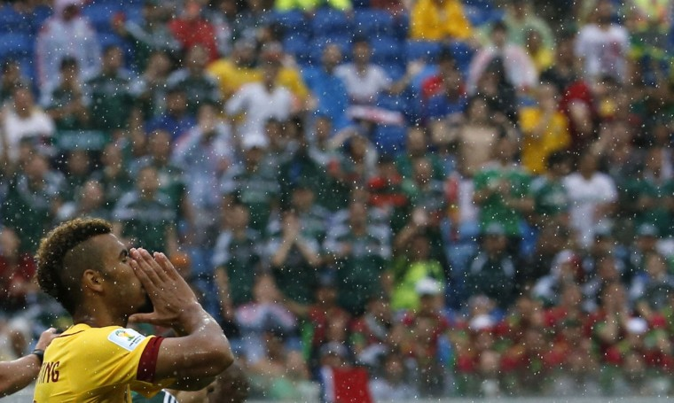 Cameroon's Eric-Maxim Choupo Moting reacts after missing a chance at scoring a goal against Mexico during their 2014 World Cup Group A soccer match at the Dunas arena in Natal June 13, 2014. (Jorge Silva/Reuters)