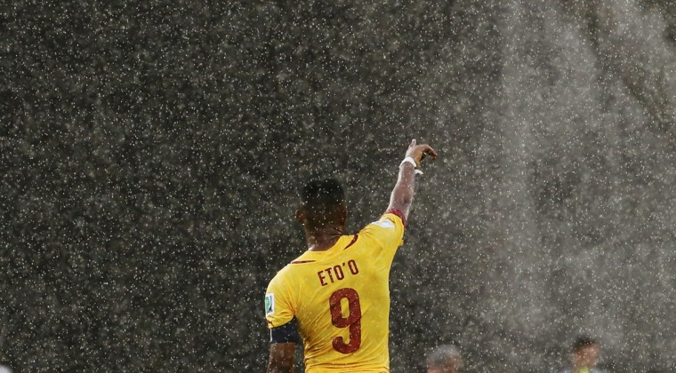 Cameroon's Samuel Eto'o gestures in the rain during their 2014 World Cup Group A soccer match against Mexico at the Dunas arena in Natal June 13, 2014. (Jorge Silva/Reuters)
