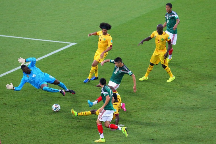 Oribe Peralta of Mexico shoots and scores a goal past Charles Itandje of Cameroon in the second half during the 2014 FIFA World Cup Brazil Group A match between Mexico and Cameroon at Estadio das Dunas on June 13, 2014 in Natal, Brazil. (Photo by Miguel Tovar/Getty Images)
