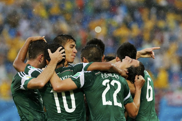 Mexico's players celebrate their goal against Cameroon during their 2014 World Cup Group A soccer match at the Dunas arena in Natal June 13, 2014. (Jorge Silva/Reuters)