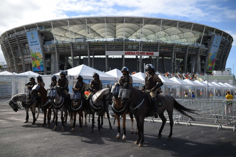 Mounted policemen guard the Fonte Nova Arena in Salvador before a Group B football match between Spain and the Netherlands during the 2014 FIFA World Cup on June 13, 2014. (Dimitar Dilkoff/AFP/Getty Images)