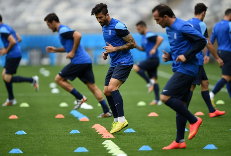 Greece's midfielder Panagiotis Kone (C) warms up with his teammates during a training session at Mineirao Stadium in Belo Horizonte on June 13, 2014, on the eve of their Group C FIFA World Cup football match against Colombia. (Eitan Abramovich/AFP/Getty Images)