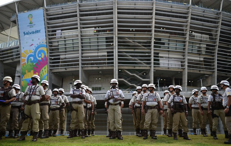 Policemen guard the Fonte Nova Arena in Salvador before a Group B football match between Spain and the Netherlands during the 2014 FIFA World Cup on June 13, 2014. (Dimitar Dilkoff/AFP/Getty Images)