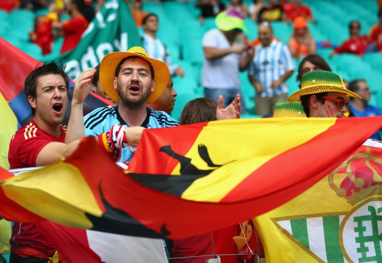 Fans wave a flag before the 2014 FIFA World Cup Brazil Group B match between Spain and Netherlands at Arena Fonte Nova on June 13, 2014 in Salvador, Brazil. (Photo by Ian Walton/Getty Images)