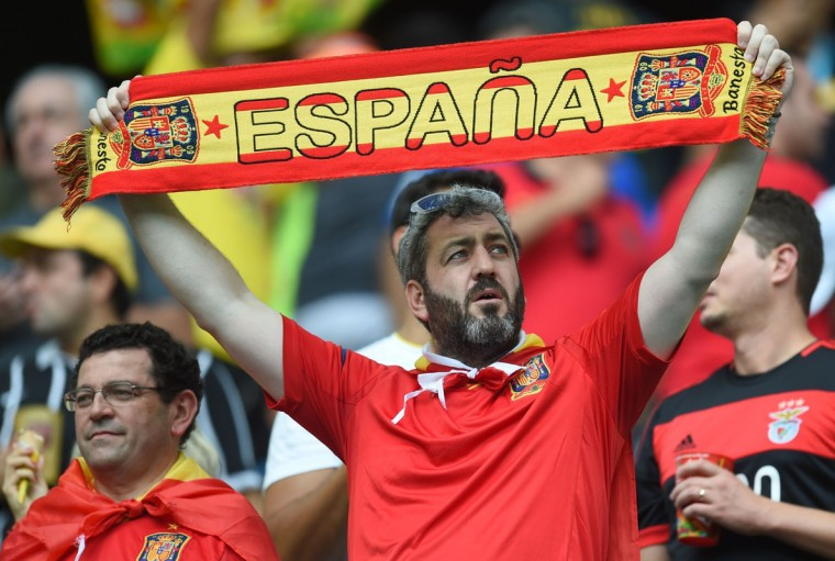 Spain's supporters wait for the start of a Group B football match between Spain and the Netherlands at the Fonte Nova Arena in Salvador during the 2014 FIFA World Cup on June 13, 2014. (Emmanuel Duand/AFP/Getty Images)