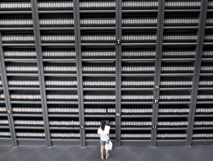 A girl reading the files of victims killed during the Nanjing massacre in Nanjing Massacre Memorial Hall in Nanjing, east China's Jiangsu province. Japan lashed out at China for politicizing a UN agency with a bid to register papers on its wartime sexual slavery and the Nanjing massacre in a global document trove. (AFP/Getty Images)