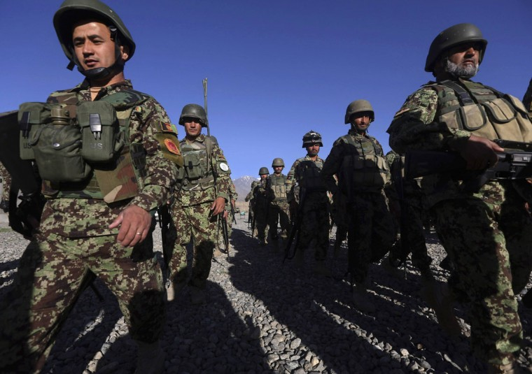 Afghan National Army (ANA) soldiers prepare to leave their base for a patrol at polling stations in the outskirts of Kabul June 12, 2014. The second round of Afghanistan's presidential election will be held on June 14. (Omar Sobhani/Reuters)