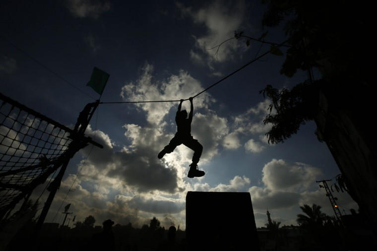 A young Palestinian takes part in a military-style exercise at a summer camp organized by Hamas movement in Gaza City June 12, 2014. Hamas stages dozens of military-style summer camps for young Palestinians in Gaza strip to prepare them to confront any possible Israeli attack, organisers said. (Suhaib Salem/Reuters)