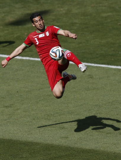 Iran's midfielder Ehsan Hajsafi plays the ball during the Group F football match between Argentina and Iran at the Mineirao Stadium in Belo Horizonte during the 2014 FIFA World Cup in Brazil on June 21, 2014. (Adrian Dennis/AFP/Getty Images)