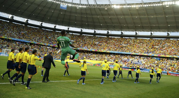 Ivory Coast's Didier Drogba jumps in the air as he enters the pitch before the start of their 2014 World Cup Group C soccer match against Greece at the Castelao arena in Fortaleza June 24, 2014. (Marcelo Del Pozo/Reuters)