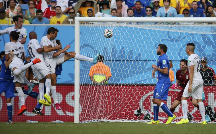 Uruguay's Diego Godin scores a goal during the 2014 World Cup Group D soccer match between Uruguay and Italy at the Dunas arena in Natal June 24, 2014. (Yves Herman/Reuters)