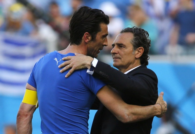 Italy's goalkeeper Gianluigi Buffon and coach Cesare Prandelli hug after the 2014 World Cup Group D soccer match between Uruguay and Italy at the Dunas arena in Natal June 24, 2014. (Yves Herman/Reuters)