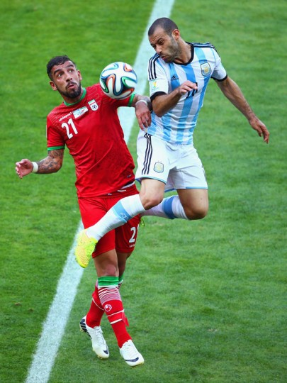Ashkan Dejagah of Iran competes for the ball with Javier Mascherano of Argentina during the 2014 FIFA World Cup Brazil Group F match between Argentina and Iran at Estadio Mineirao on June 21, 2014 in Belo Horizonte, Brazil. (Photo by Ian Walton/Getty Images)
