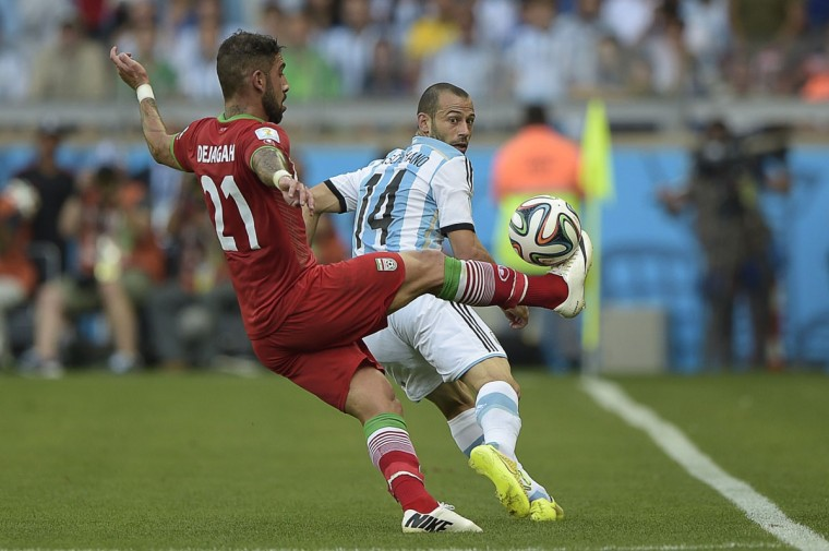 Iran's forward Ashkan Dejagah (L) and Argentina's midfielder Javier Mascherano vie for the ball during a Group F football match between Argentina and Iran at the Mineirao Stadium in Belo Horizonte during the 2014 FIFA World Cup in Brazil on June 21, 2014. (Juan Mabromata/AFP/Getty Images)