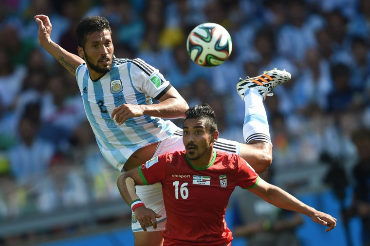 Argentina's defender Ezequiel Garay (L) and Iran's forward Reza Ghoochannejhad vie for the ball during a Group F football match between Argentina and Iran at the Mineirao Stadium in Belo Horizonte during the 2014 FIFA World Cup in Brazil on June 21, 2014. (Pedro Ugarte/AFP/Getty Images)