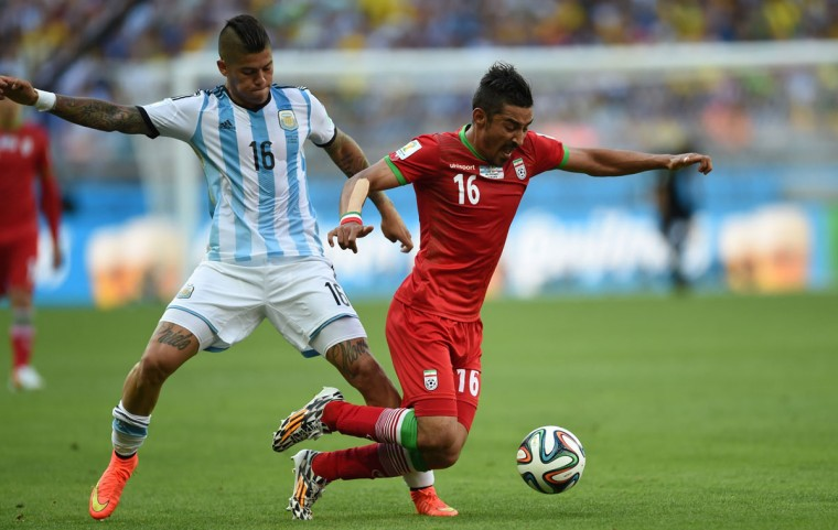 Argentina's defender Marcos Rojo (L) and Iran's forward Reza Ghoochannejhad vie during the Group F football match between Argentina and Iran at the Mineirao Stadium in Belo Horizonte during the 2014 FIFA World Cup in Brazil on June 21, 2014. (Behrouz Mehri/AFP/Getty Images)