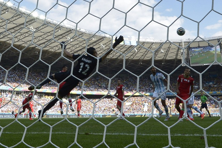 Iran's goalkeeper Alireza Haqiqi (L) saves the ball during a Group F football match between Argentina and Iran at the Mineirao Stadium in Belo Horizonte during the 2014 FIFA World Cup in Brazil on June 21, 2014. (Juan Mabromata/AFP/Getty Images)