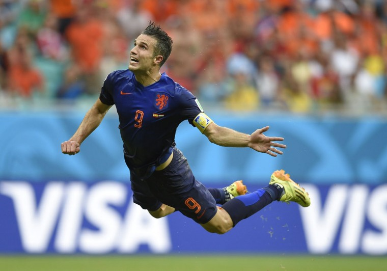 Netherlands' forward Robin van Persie scores during a Group B football match between Spain and the Netherlands at the Fonte Nova Arena in Salvador during the 2014 FIFA World Cup on June 13, 2014. (Lluis Gene/AFP/Getty Images)