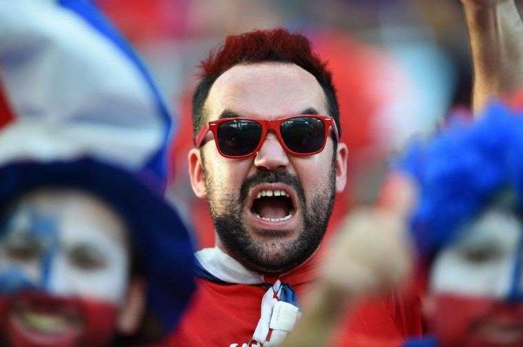 A Chilean football fan cheers for his team before the start of the Group B football match between Chile and Australia at the Pantanal Arena in Cuiaba during the 2014 FIFA World Cup on June 13, 2014. (Martin Bernetti/AFP/Getty Images)