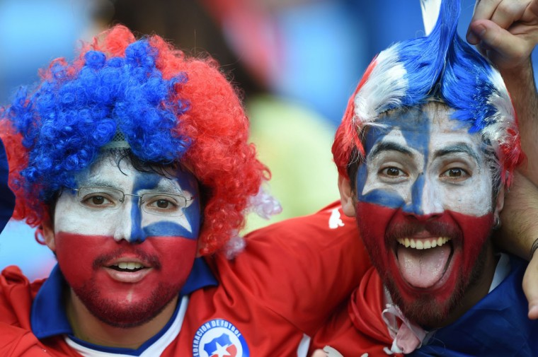 Chilean football fans cheer for their team before the start of the Group B football match between Chile and Australia at the Pantanal Arena in Cuiaba during the 2014 FIFA World Cup on June 13, 2014. (Martin Bernetti/AFP/Getty Images)