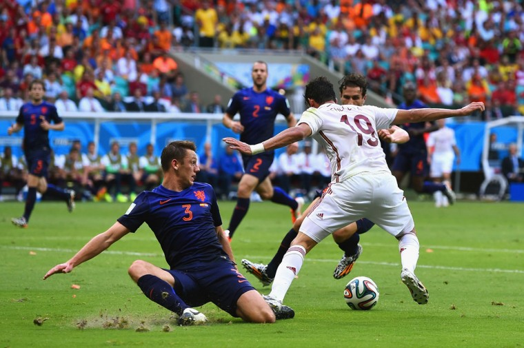 Diego Costa of Spain is fouled by Stefan de Vrij of the Netherlands and awarded a penalty in the first half during the 2014 FIFA World Cup Brazil Group B match between Spain and Netherlands at Arena Fonte Nova on June 13, 2014 in Salvador, Brazil. (Photo by David Ramos/Getty Images)