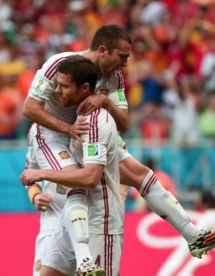 Spain's midfielder Xabi Alonso (front) celebrates after scoring a penalty during a Group B football match between Spain and the Netherlands at the Fonte Nova Arena in Salvador during the 2014 FIFA World Cup on June 13, 2014. (Damien Meyer/AFP/Getty Images)