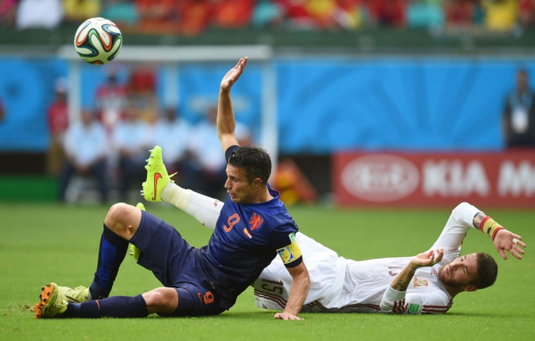 Netherlands' forward Robin van Persie (L) vies with Spain's defender Sergio Ramos (R) during a Group B football match between Spain and the Netherlands at the Fonte Nova Arena in Salvador during the 2014 FIFA World Cup on June 13, 2014. (Emmanuel Duand/AFP/Getty Images)