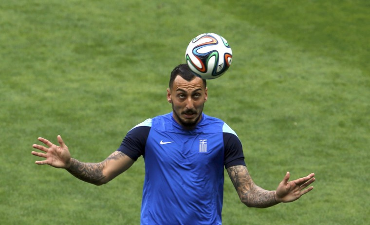 Greece's Konstantinos Mitroglou heads the ball during a training session at Mineirao stadium in Belo Horizonte June 13, 2014. The Greek squad will face Colombia in their first 2014 World Cup match in Belo Horizonte on Saturday. (Sergio Perez/Reuters)
