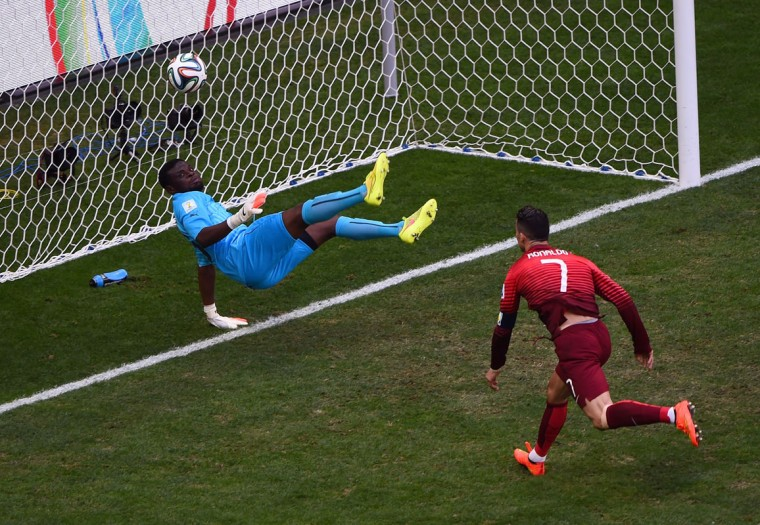 Goalkeeper Fatawu Dauda of Ghana makes a save at a header at goal by Cristiano Ronaldo of Portugal during the 2014 FIFA World Cup Brazil Group G match between Portugal and Ghana at Estadio Nacional on June 26, 2014 in Brasilia, Brazil. (Christopher Lee/Getty Images)