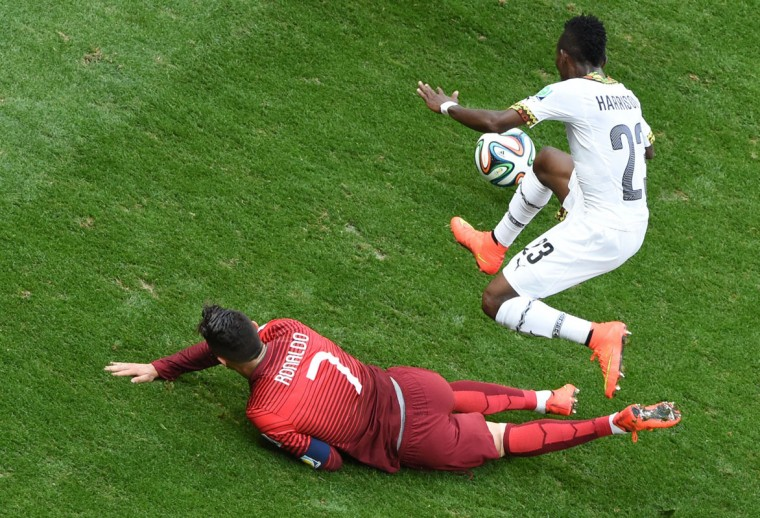 Portugal's forward and captain Cristiano Ronaldo (L) and Ghana's defender Harrison Afful vie for the ball during the Group G football match between Portugal and Ghana at the Mane Garrincha National Stadium in Brasilia during the 2014 FIFA World Cup on June 26, 2014. (Evaristo Sa/AFP/Getty Images)