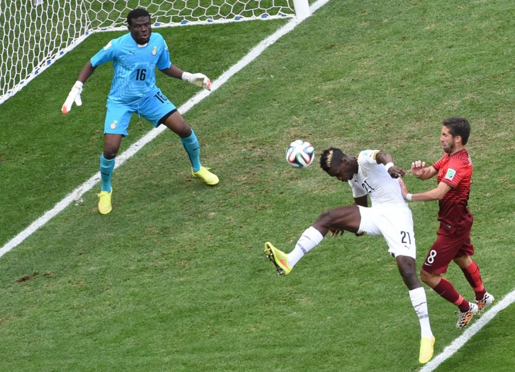 Ghana's defender John Boye (C) hits the ball to score an own goal as Portugal's midfielder Joao Moutinho (R) watches on and Ghana's goalkeeper Fatau Dauda tries to defend during the Group G football match between Portugal and Ghana at the Mane Garrincha National Stadium in Brasilia during the 2014 FIFA World Cup on June 26, 2014. (Evaristo Sa/AFP/Getty Images)