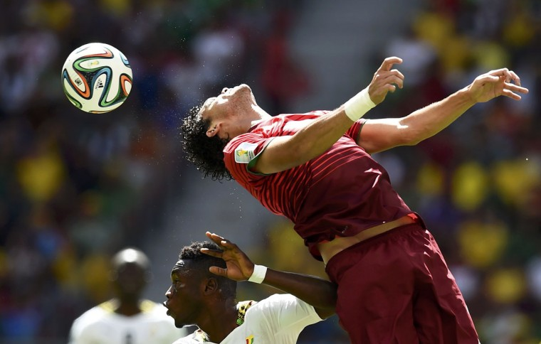 Portugal's Pepe (top) jumps for the ball against Ghana's Abdul Majeed Waris during their 2014 World Cup Group G soccer match at the Brasilia national stadium in Brasilia June 26, 2014. (Dylan Martinez/Reuters)