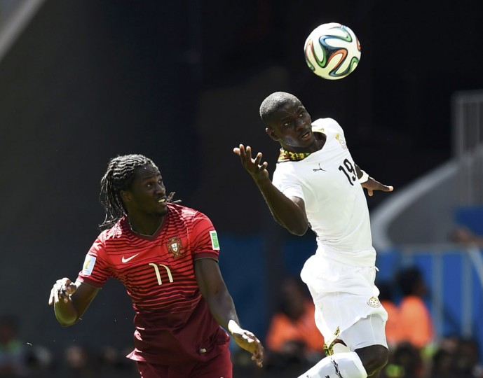 Ghana's Jonathan Mensah (R) fights for the ball with Portugal's Eder during their 2014 World Cup Group G soccer match at the Brasilia national stadium in Brasilia June 26, 2014. (Dylan Martinez/Reuters)