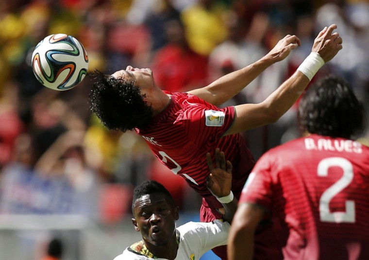 Portugal's Pepe (top) jumps for the ball against Ghana's Abdul Majeed Waris during their 2014 World Cup Group G soccer match at the Brasilia national stadium in Brasilia June 26, 2014. (Ueslei Marcelino/Reuters)